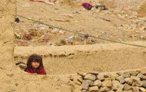A curious little girl in poverty