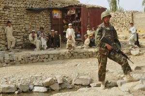 An afghan army soldier on foot patrol