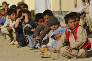 Orphaned boys are curious to see what the American