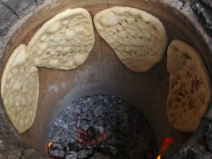 The clay oven where he sticks the bread to the wal
